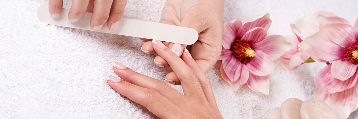 lady having nails manicured